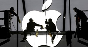 Workers prepare a new Apple store in Hangzhou, China