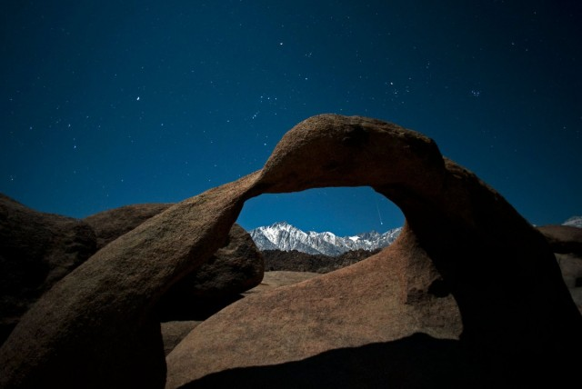 Geminid Meteor Framed Within Mobuis Arch
